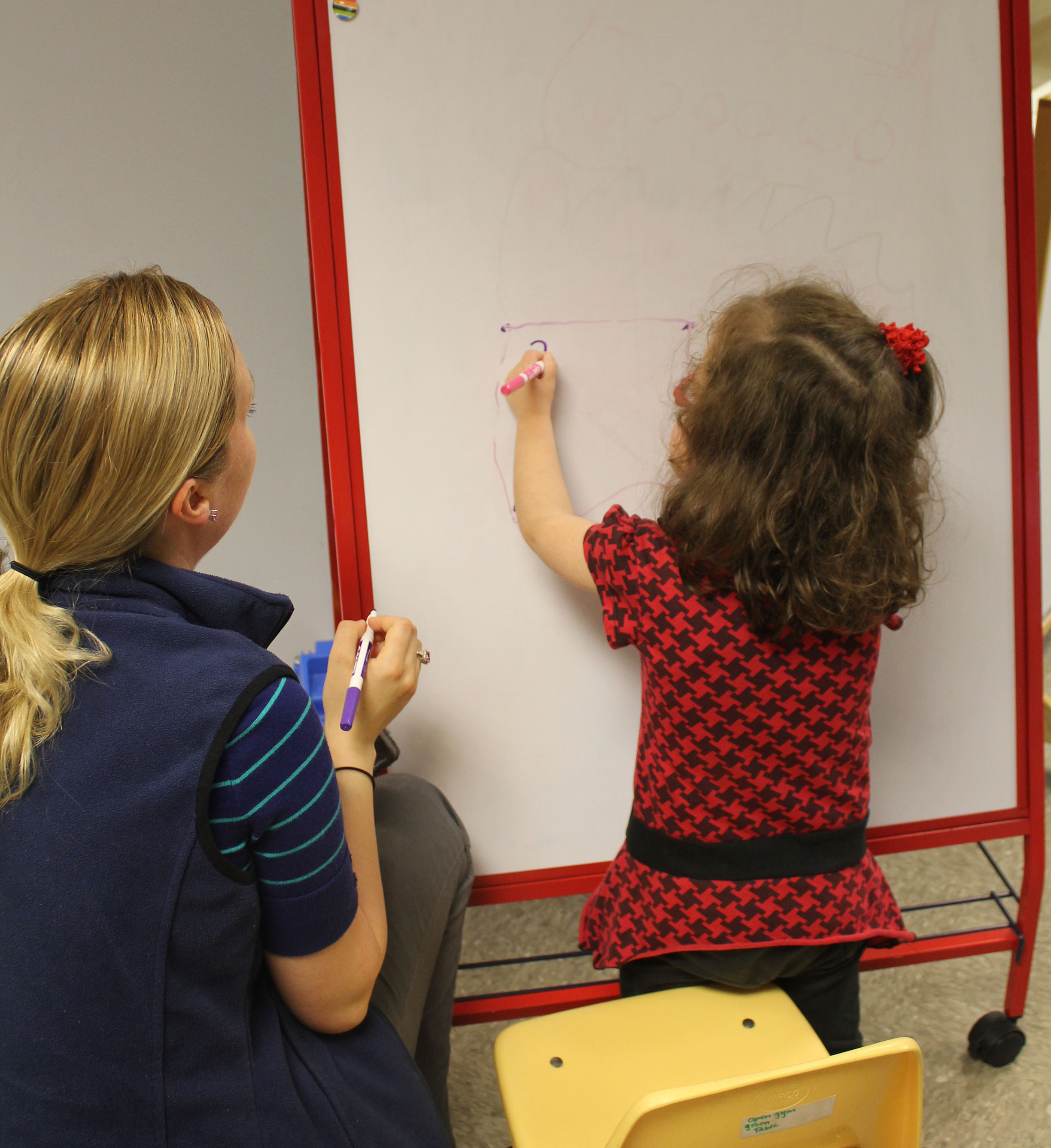 One-On-One Child Writing on White Board